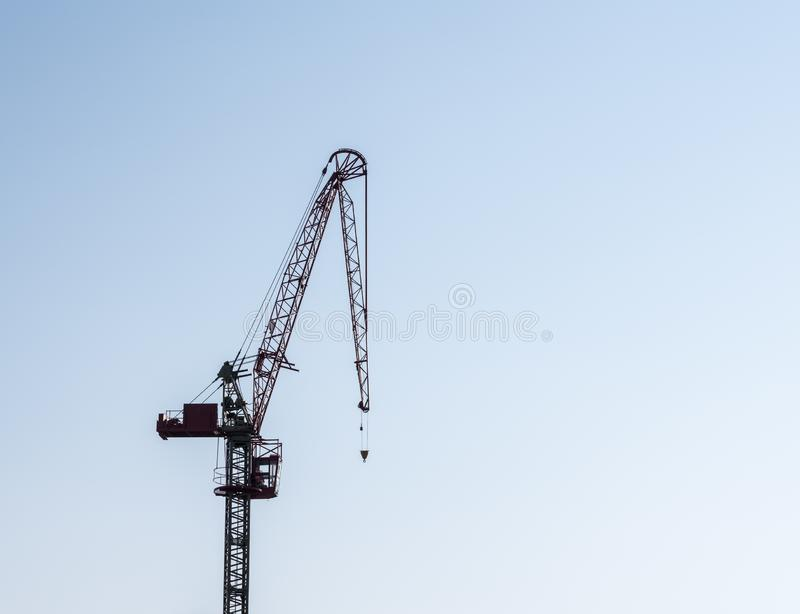 Modern construction crane with serious drooping problem. Concept for erectile dysfunction with large crane with drooping structure stock image