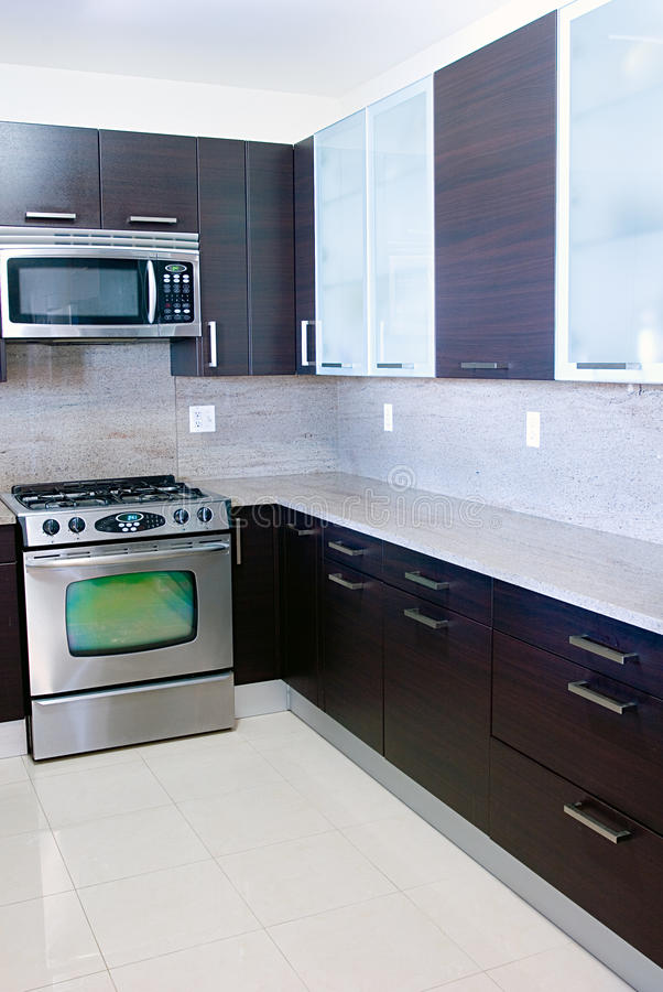 Modern contemporary style kitchen with granite top stock photos