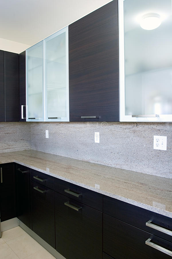 Modern Contemporary Style Wood And Glass Kitchen Royalty Free Stock Photos