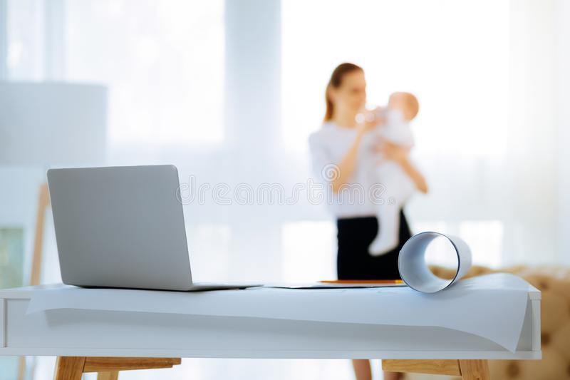 Modern convenient laptop standing on a table. Necessary tools. New modern powerful laptop being placed on the table for a young businesswoman royalty free stock images