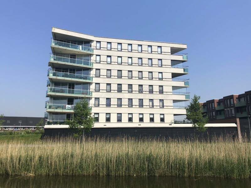 Modern corner apartment building in Almere Poort. stock images