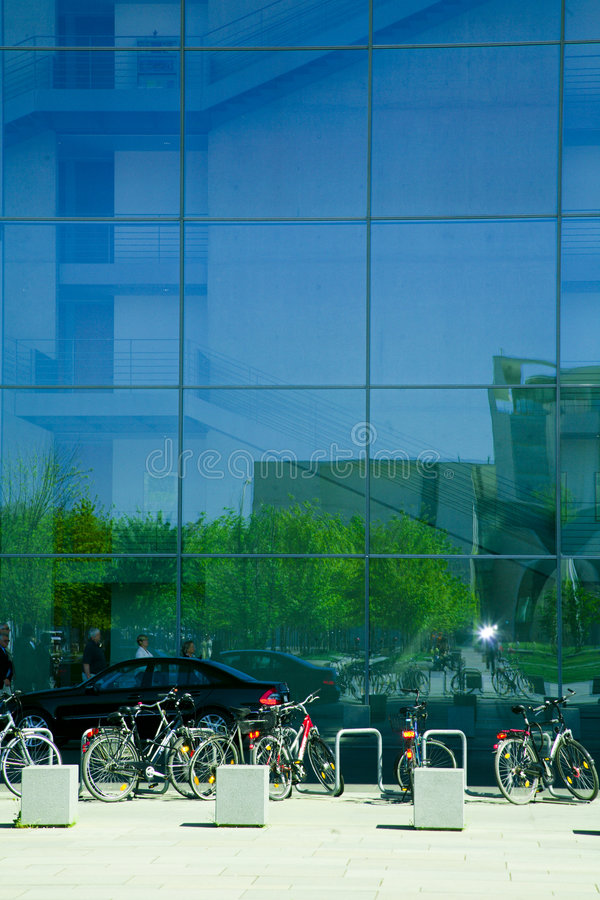 Modern corporate building. Modern glass corporate building in Berlin with lots of bicycles stock photo