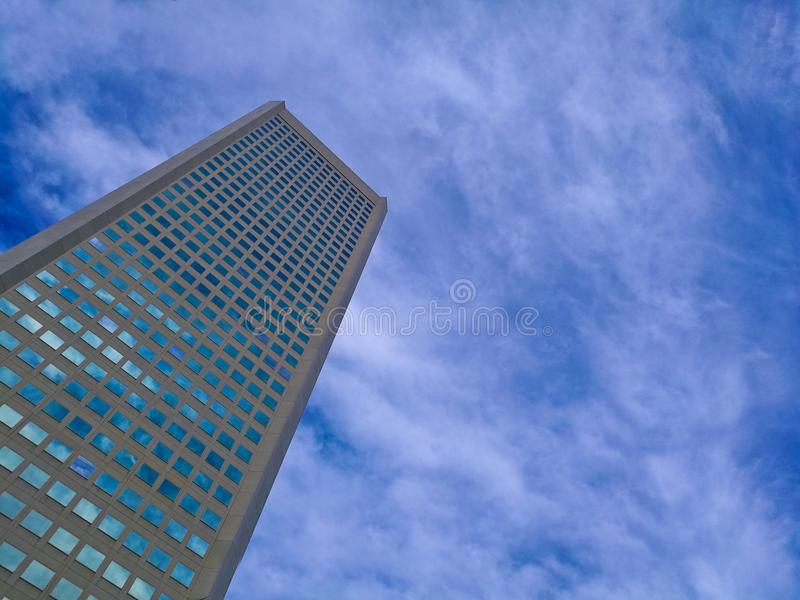 Modern corporate office building with blue sky summer stock image