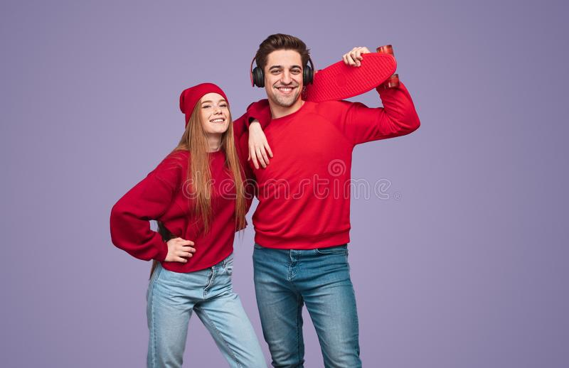 Modern couple smiling for camera together royalty free stock images