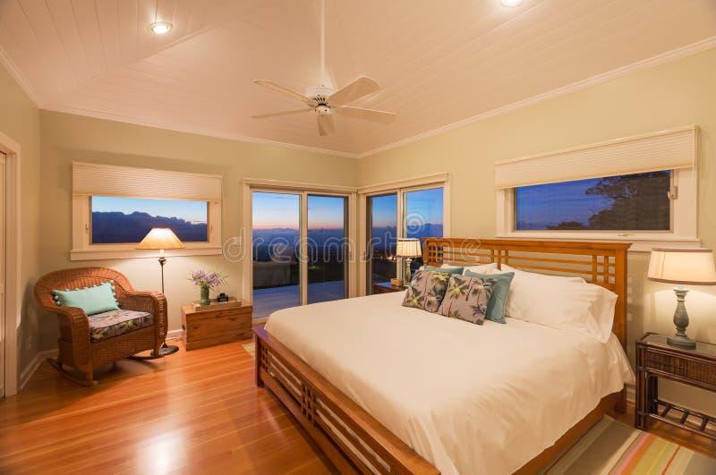 Modern cozy Bedroom wooden floor stock photos