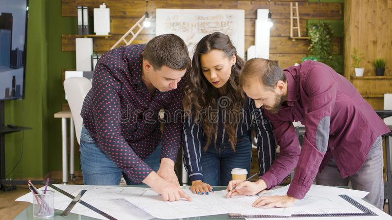 In modern and cozy office team of architects and designers are working royalty free stock image
