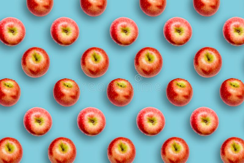 Modern creative healthy snack food concept Pattern of apples on bright colourful blue background in minimalist style stock images
