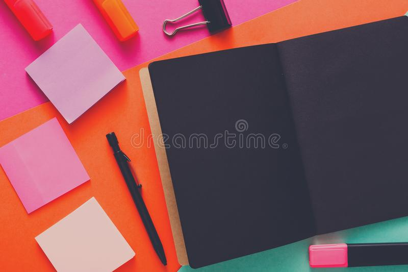 Modern creative work space with stylish black notepad stock images