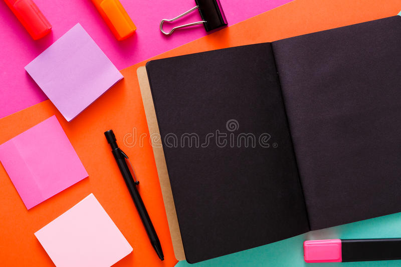 Modern creative work space with stylish black notepad royalty free stock photos
