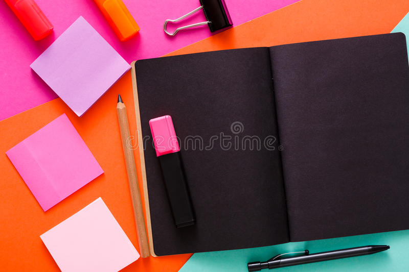 Modern creative work space with stylish black notepad stock photo