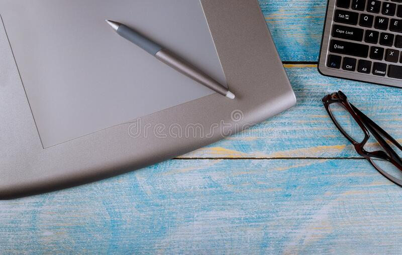 Modern creative workspace creative graphic designer desk. Modern creative workspace graphic designer desk on wooden table royalty free stock photo