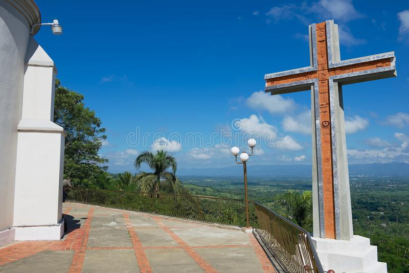 Modern cross overlooking the valley of Cibao next to the Church of Our Lady of Mercedes in Santo Cerro, Dominican Republic. royalty free stock photo