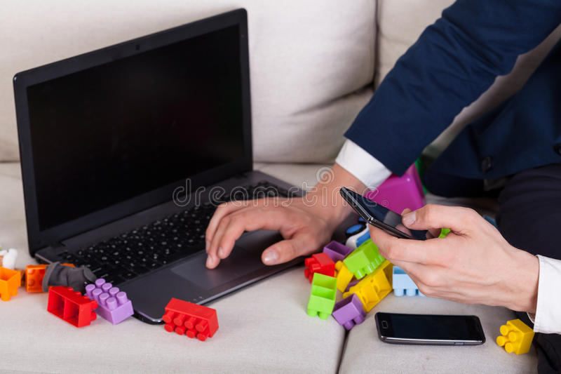 Modern dad working at home stock photo