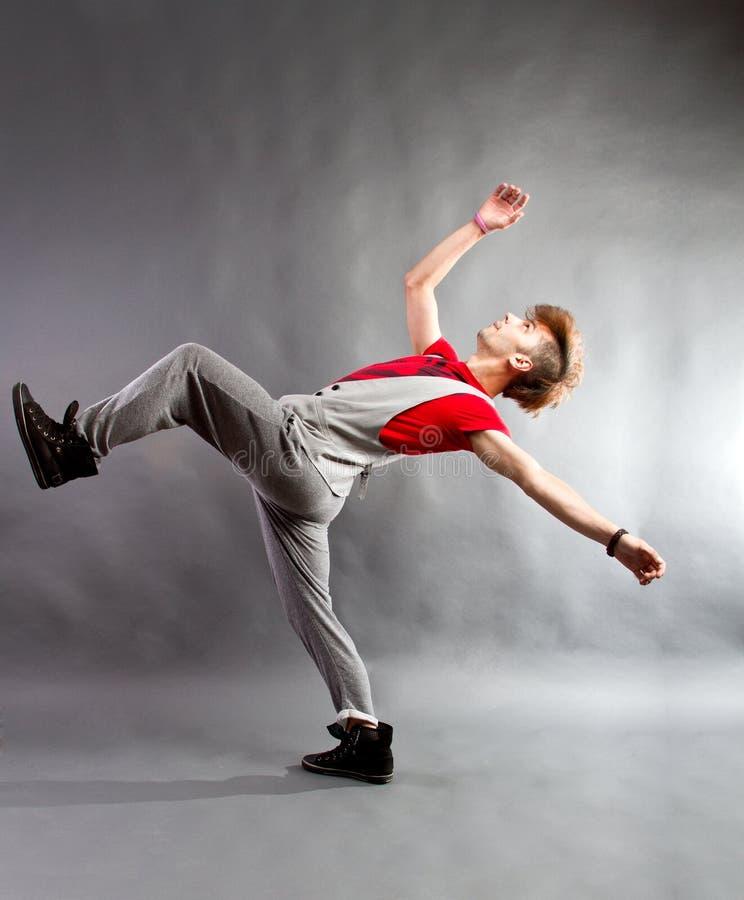 Modern dancer. Modern style dancer performing on studio background stock photo