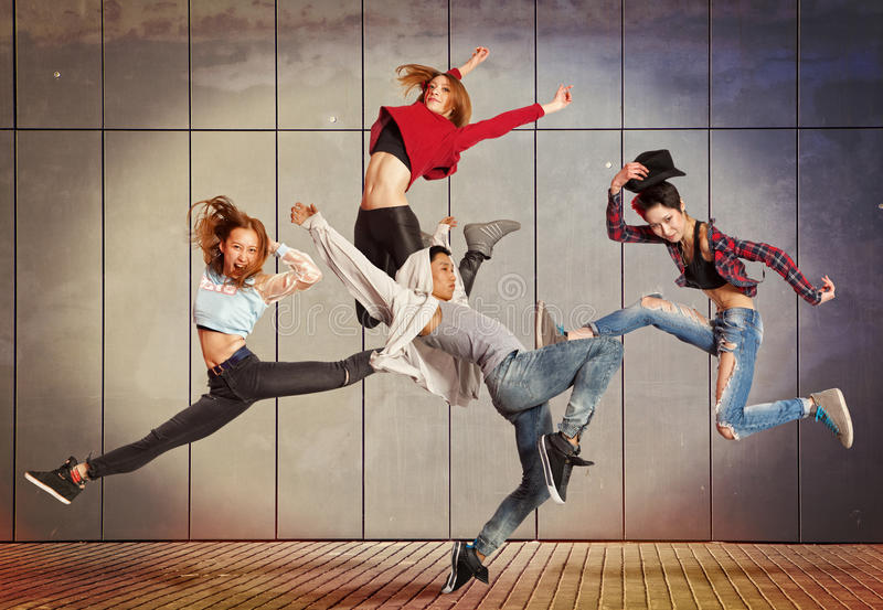 Modern dancing group practice dancing in front wall royalty free stock photos