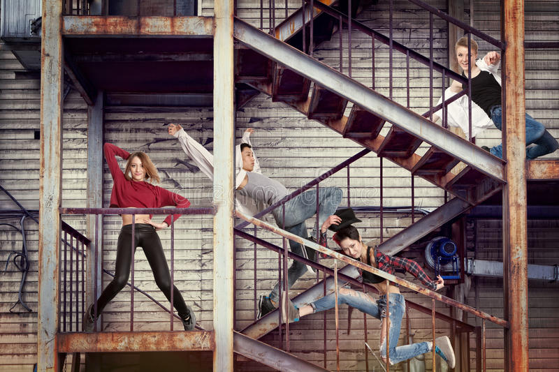 Modern dancing group practice dancing in front wall royalty free stock photography