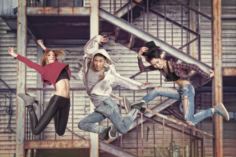 Modern dancing group practice dancing in front wall royalty free stock photo