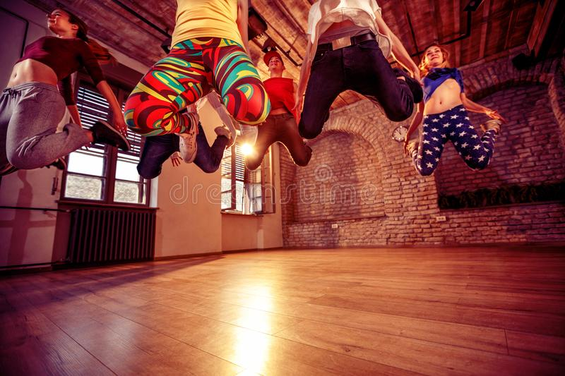 Modern dancing group practice dancing in jump royalty free stock images