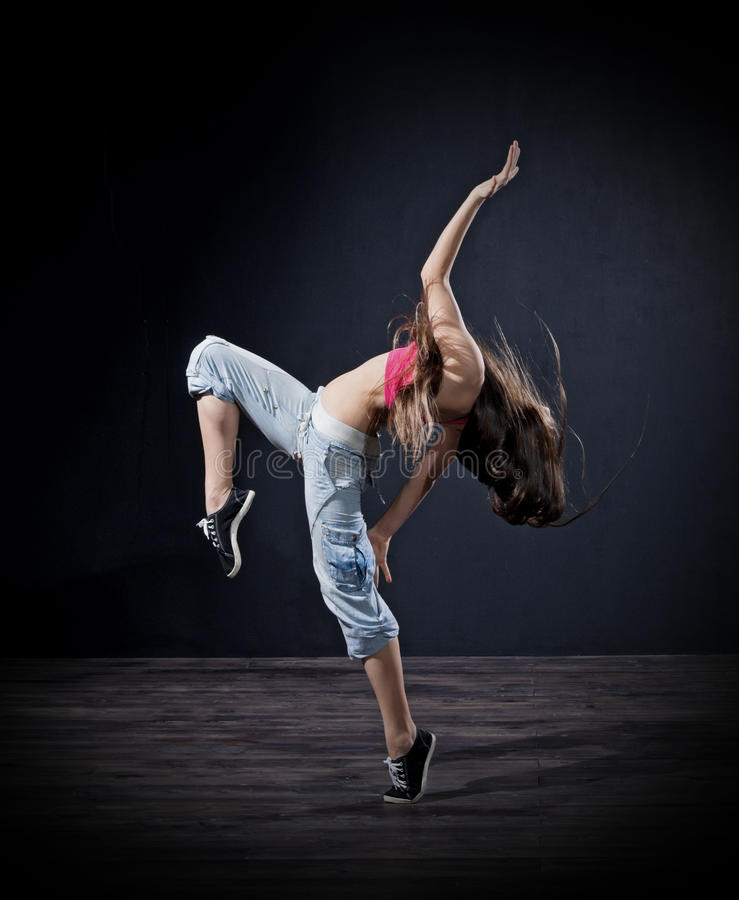 Modern dansare för ung flicka (mörk ver) royaltyfria bilder