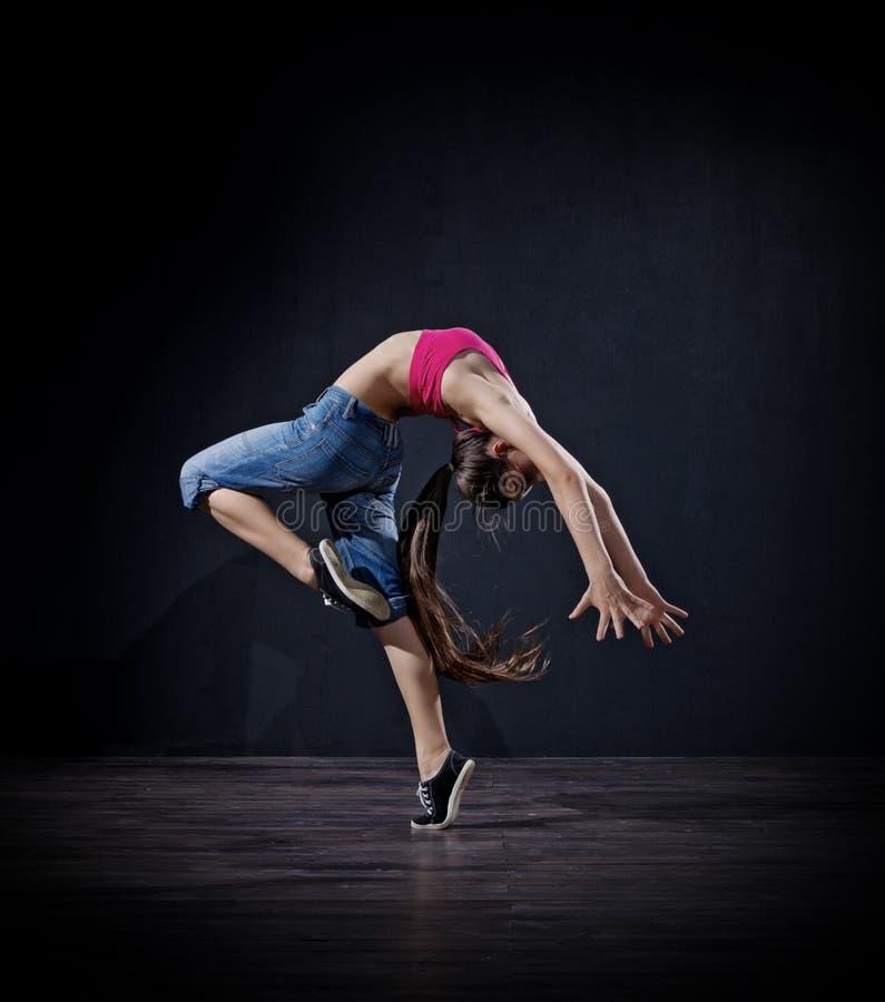Modern dansare för ung flicka (mörk ver) royaltyfri foto