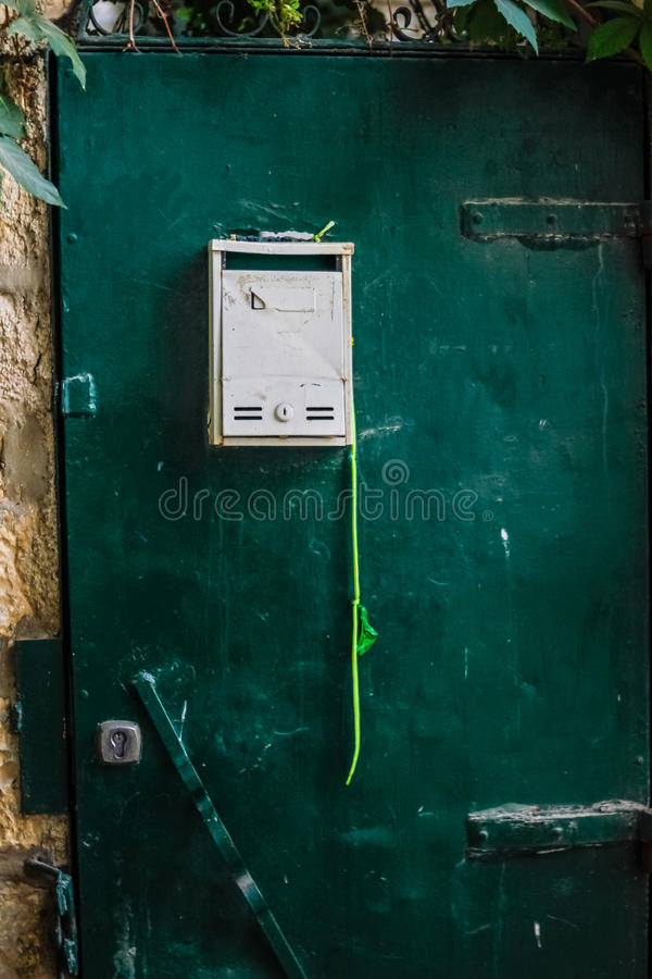 Modern Dark green emerald metal dirt door with keyhole and rusty metal lockas a beautiful vintage background stock image