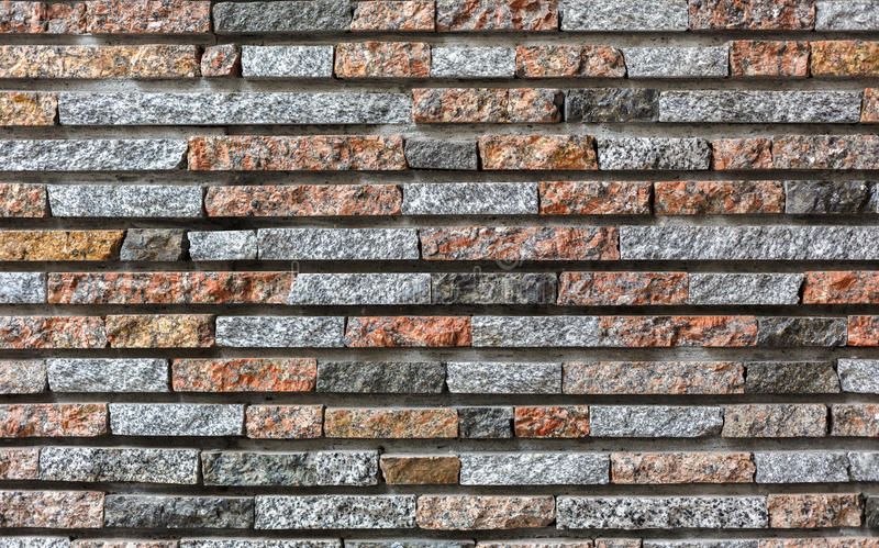 Modern decorative colored stone brick wall background. Modern decorative colored stone wall background. Brick wall style stucco texture pattern, building facade stock photos