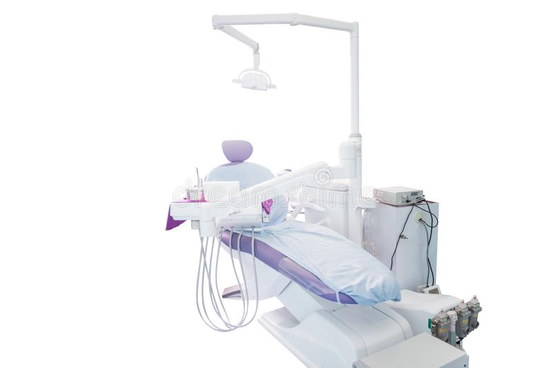 Modern dental practice. Dental chair and other accessories royalty free stock image