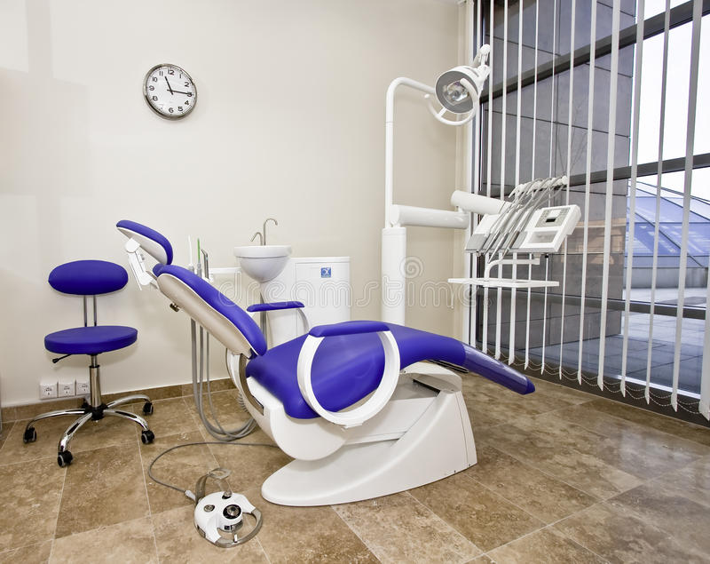 Modern dentist's chair in a medical room. stock image