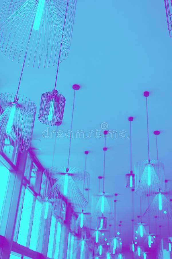 Modern design of chandelier hanging on ceiling. stock photo