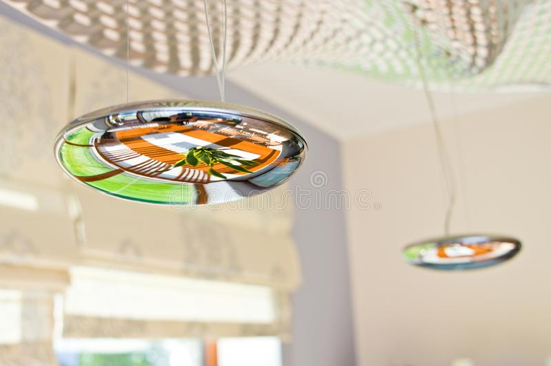Modern chandelier in form of metal droplets stock photography
