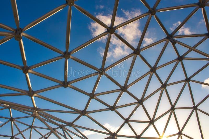 Modern design curved steel frame structure under a blue sky. Modern design curved steel metal frame structure under a blue sky stock images