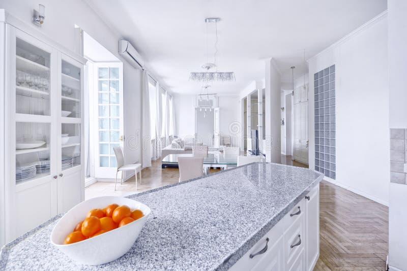 Modern design white kitchen in a spacious apartment stock photo