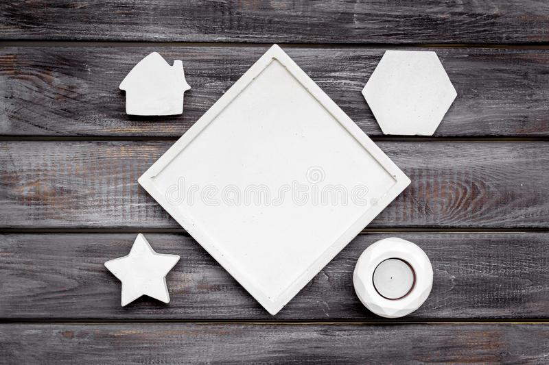 Modern design of work desk with candle, house and star figures on wooden background top view copy space. Home decoration. Modern design of work desk with candle stock photos