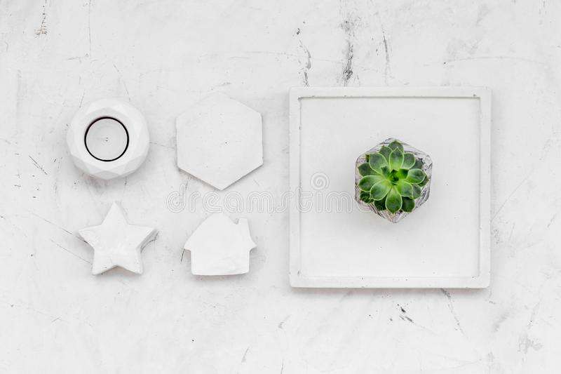 Modern design of work desk with plant, candle, house and star figures on white marble background top view. Home decoration. Modern design of work desk with plant royalty free stock photos