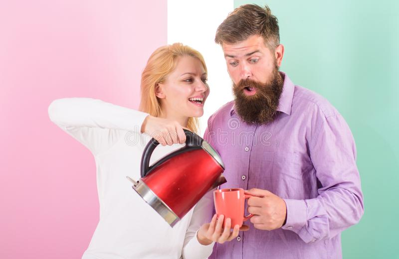 Modern devices make our life easier. Prepare favourite drink in minutes. Spending good morning together. Couple prepare. Morning drink electric kettle device stock photos