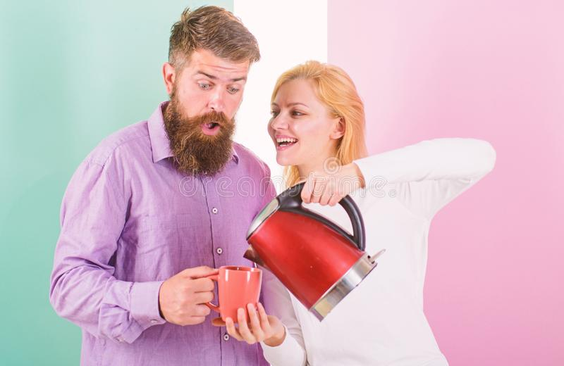 Modern devices make our life easier. Prepare favourite drink in minutes. Spending good morning together. Couple prepare. Morning drink electric kettle device royalty free stock images