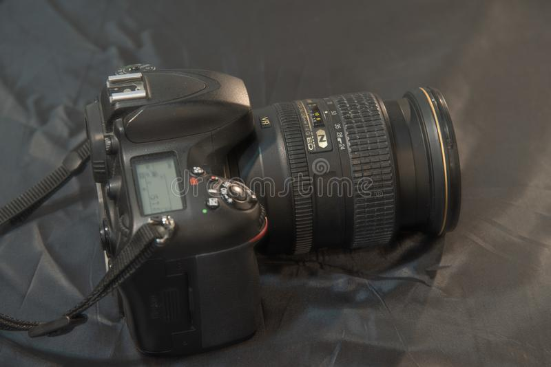 Professional digital camera with zoom lens. Photography business concept. royalty free stock photos