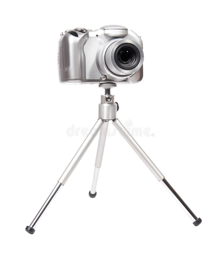 Modern digital camera with tripod stock photography