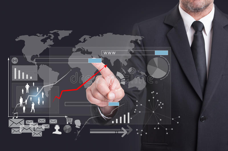 Modern digital icon on virtual screen touched by businessman. Representing global financial investment stock photo