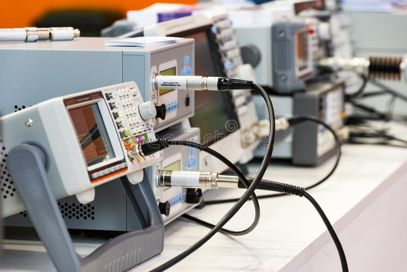 Modern digital measuring instruments. Multimetric equipment. stock images