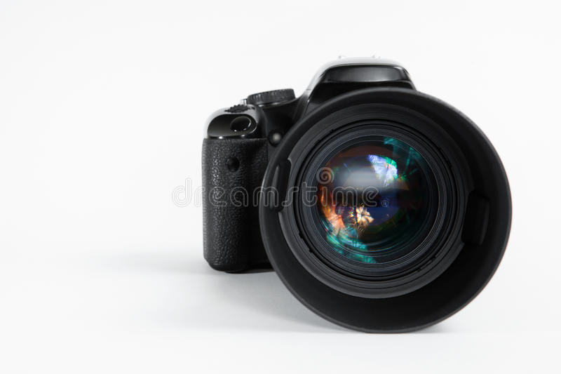 Modern digital photo camera with 85 mm photo lens royalty free stock photo