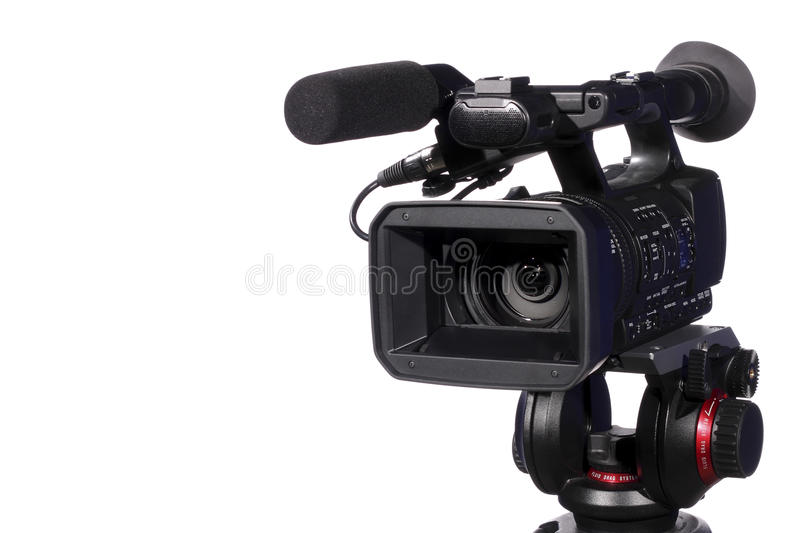 Modern digital video camera. Isolated over white stock photography