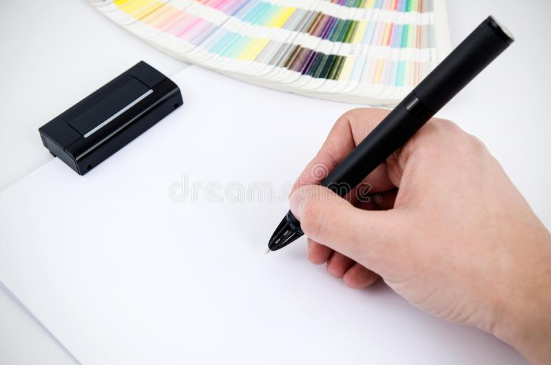 Modern digitized pen and color card in background. Graphic designer working with modern digitized pen stock photo