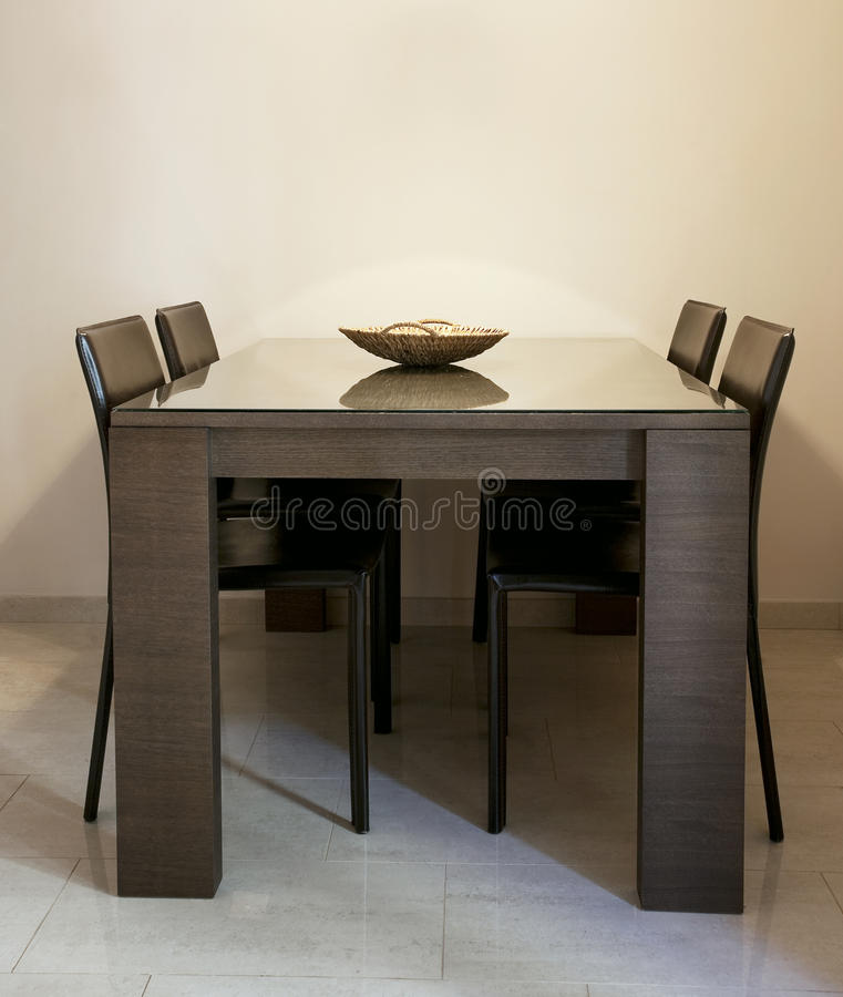Modern dining room. With brown chairs and a table with glass coating stock photography