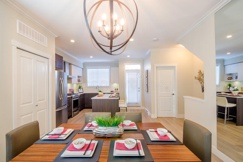 Modern dining room and kitchen stock image