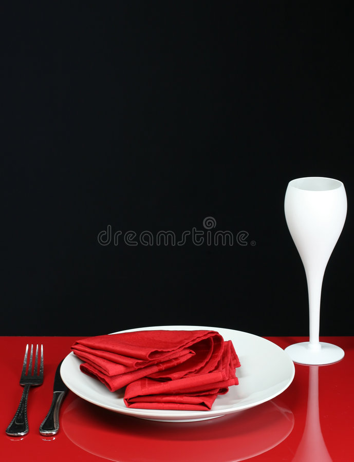Modern Dinner Table. An elegant red dinner table with wine glass stock photos
