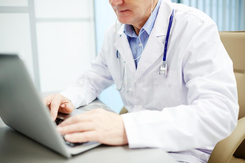 Modern doctor using laptop in office royalty free stock images