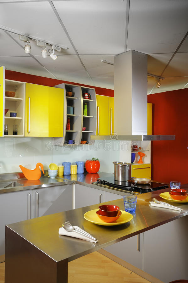 Modern domestic kitchen 02. Modern domestic kitchen with yellow wall cupboards royalty free stock images