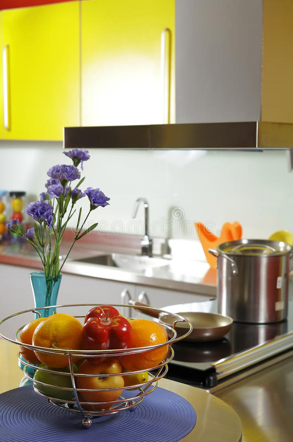 Modern domestic kitchen. With yellow wall cupboards stock photos