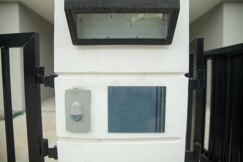 Modern door bell with lamp stock photo